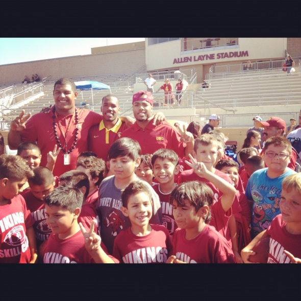 USC Football players (Left to Right - Zach Banner, Jabari Ruffin, and TJ McDonald) visit a youth football camp at Downey high school. (Photo from TJ Mcdonald)