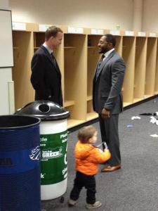 Broncos QB Peyton Manning stayed to congratulate Ravens LB Ray Lewis after tonight's playoff game. (Photo by Chad Steele)