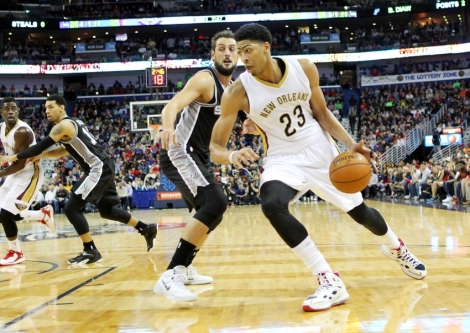 Dec 26, 2014; New Orleans, LA, USA; New Orleans Pelicans forward Anthony Davis (23) drives the ball around San Antonio Spurs guard Marco Belinelli (3) in the second half at the Smoothie King Center. New Orleans defeated San Antonio 97-90. Mandatory Credit: Crystal LoGiudice-USA TODAY Sports