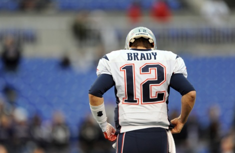 New England Patriots quarterback Tom Brady warms up before an NFL football game against the Baltimore Ravens, Sunday, Dec. 22, 2013, in Baltimore. (AP Photo/Gail Burton) ORG XMIT: OTK